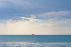 Seascape with boat. Seascape with sailing vintage boat Stock Images