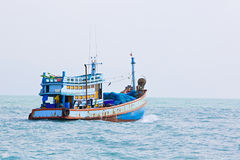 Seascape with a boat in blue colors Royalty Free Stock Images