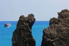 Seascape with boat and rock somewhere in the Five lands Cinque Terre in Italy. Seascape with boat and rock somewhere in the Five lands in Italy royalty free stock image