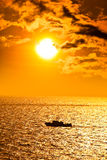 Seascape with boat at sunset Royalty Free Stock Photography
