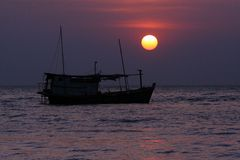 Seascape with boat and sunset Stock Photo