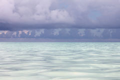 Seascape - bright azure Caribbean Sea and cumulus clouds. Stock Photos