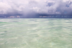Seascape - bright azure Caribbean Sea and cumulus clouds. Royalty Free Stock Image