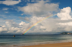 Seascape with bright sky and rainbow Stock Photo
