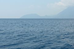 Seascape with the calm sea and an island on horizon Turkey. royalty free stock image