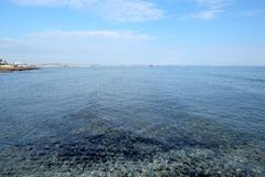 Seascape with calm transparent clear water at sea coast in low season on resort place on sunny day stock images