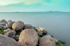 Seascape. The calmness of the water makes it peaceful enough for someone to sleep stock images