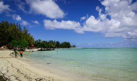 Seascape of Cap Malheureux, Mauritius. Malheureux, Mauritius - Jan 7, 2017. People enjoy on beach in Cap Malheureux, Mauritius. Mauritius is a major tourist Royalty Free Stock Image