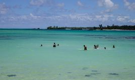 Seascape of Cap Malheureux, Mauritius. Malheureux, Mauritius - Jan 7, 2017. People swimming on sea in Cap Malheureux, Mauritius. Mauritius is a major tourist Royalty Free Stock Photo