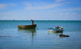 Seascape of Cap Malheureux, Mauritius. Malheureux, Mauritius - Jan 7, 2017. People working on sea in Cap Malheureux, Mauritius. Mauritius is a major tourist Royalty Free Stock Images