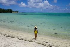 Seascape of Cap Malheureux, Mauritius. A woman standing and looking at the blue sea on Mauritius Island Stock Images
