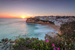 The seascape of Carvoeiro at sunset in a long exposure. Stock Image