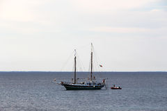 Seascape with a classic sailboat and tender Royalty Free Stock Images