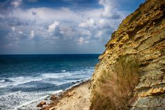 Seascape, clear sky. Summer panorama, green vegetation. Calm sea. Clear sky stock images