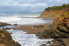 Seascape of Cliffs on Rocky and Sandy Pacific Ocean Coast of Central California. Dramatic Seascape of Rocky Intertidal Zone of Cambria State Marine Conservation royalty free stock photo