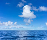 Seascape with clouds and blue sky Royalty Free Stock Photo