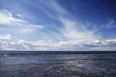 Seascape with clouds and blue sky. Background. White sea, summer Royalty Free Stock Photo