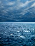 Seascape and cloudy sky. Seascape image of windy weather and waves on sea over cloudy sky Stock Image