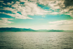 Seascape with coast and clouds vintage colors. Stock Images