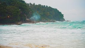 Seascape, the coast of a tropical island, waves break against the rocks on the beach, before the storm.  stock video footage