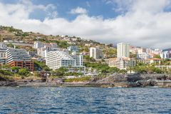 Seascape coastline Madeira Island with modern Hotels of Funchal Stock Photos