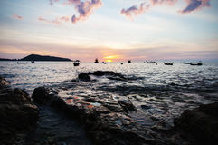 Seascape with color of sunset in shadow Stock Photos