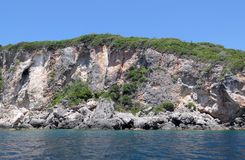 Seascape of corfu island at paradise beach of Liapades Greece. Chalk rocks along the cliff royalty free stock images