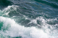 Seascape. Crashing waves in the seas. A simple picture of an empty rough sea, with waves crashing, bathed in natural light. An uncluttered background. Space royalty free stock images