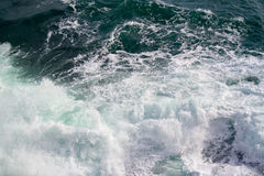 Seascape. Crashing waves in the seas. A simple picture of an empty rough sea, with waves crashing, bathed in natural light. An uncluttered background. Space stock images