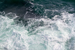 Seascape. Crashing waves in the seas. A simple picture of an empty rough sea, with waves crashing, bathed in natural light. An uncluttered background. Space Stock Image