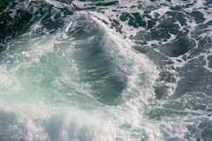 Seascape. Crashing waves in the seas. A simple picture of an empty rough sea, with waves crashing, bathed in natural light. An uncluttered background. Space Royalty Free Stock Photos