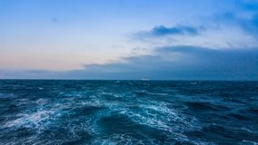 Seascape. Cruise ship in the distance on the horizon. Selective focus Stock Image