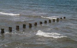 Seascape - The dark, cold, uninviting North Sea with a diagonal line of sea-breakers. Copy space Royalty Free Stock Photo