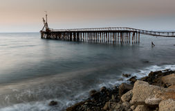 Seascape with deserted jetty during sunset Royalty Free Stock Image