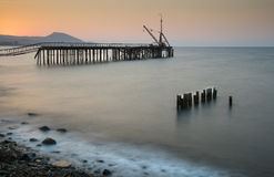 Seascape with deserted jetty during sunset Stock Image