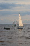 Seascape with dinghy, boat and windsurfers Royalty Free Stock Photo