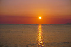 Seascape with Dramatic Orange Sunset Royalty Free Stock Photography