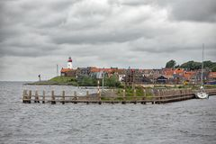 Seascape village Urk with wind turbines raising above the houses stock photo