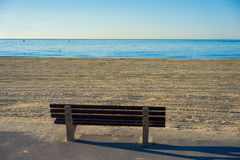Seascape with an empty bench towards the sea Stock Photos