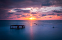 Seascape and Empty Cage at Colorful Sunset Royalty Free Stock Photo