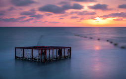 Seascape and Empty Cage at Colorful Sunset Stock Image
