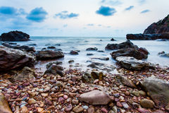 Seascape of evening wave with rock and cloud blue sky Stock Photo