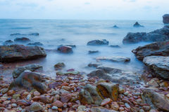 Seascape of evening wave with rock and cloud blue sky Royalty Free Stock Image
