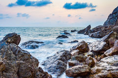 Seascape of evening wave with rock and cloud Royalty Free Stock Image
