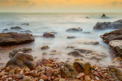 Seascape of evening wave with rock and cloud golden sky Royalty Free Stock Photography