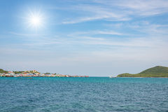Seascape with faraway fishing villages Stock Photography