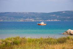 Seascape with fishernan boat. Seascape with red fishernan boat royalty free stock photo