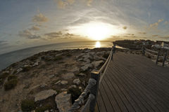 Seascape with a fisheye. Sunset at Cabo Carvoeiro in Peniche, city of Portugal. The caption was made with a fisheye lens Royalty Free Stock Images