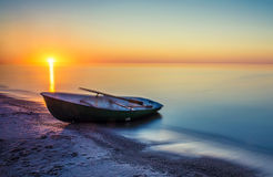 Seascape with fishing boat. Long exposure royalty free stock photo
