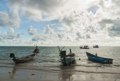 Seascape with fishing boat and storm cloud Stock Photos